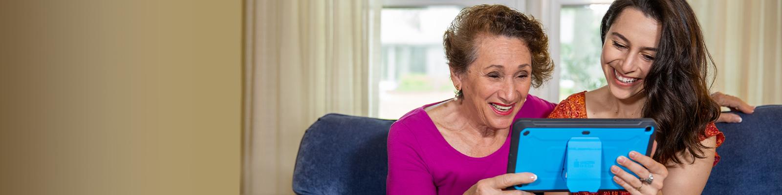 Senior living resident using the iN2L tablet