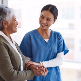 Senior living caregiver with resident